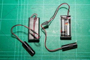 Two line laser modules powered by two external AA batteries